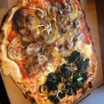 Pictured is one of our vegan pizzas: half funghi formaggi half salsiccia patate